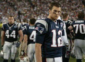 New England Patriots quarterback Tom Brady (12) looks on during the fourth quarter of the Super Bowl XLII football game against the New York Giants at University of Phoenix Stadium on Sunday, Feb. 3, 2008 in Glendale, Ariz. (Stephan Savoia / AP Photo)