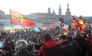 Participants in a rally from the xenophobic and anti-Islamic Pegida (Patritotic Europeans against the Islamization of the West) group gather in Dresden, Germany, Saturday Feb. 6, 2016. (Sebastian Wollnow/dpa via AP)