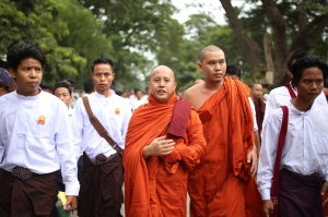 In this Sept. 21, 2015 file photo, Nationalist Buddhist monk Wirathu, centre, marches in Mandalay, the second largest city in Myanmar. (Hkun Lat / AP Photo)