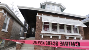 Crime scene tape surrounds a home Friday, Feb. 5, 2016, in Chicago. (AP Photo / M. Spencer Green)