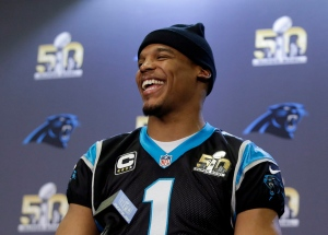 Carolina Panthers quarterback Cam Newton smiles as he fields questions during a press conference in preparation for the Super Bowl 50 football game on Feb. 4, 2016 in San Jose, Calif. (Marcio Jose Sanchez / AP Photo)