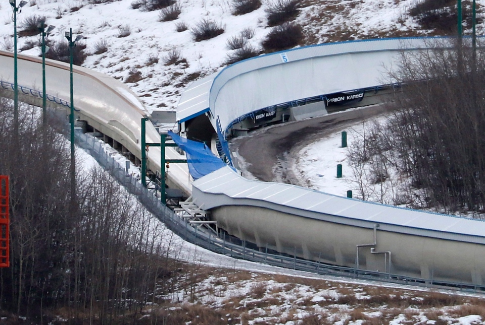 A tarp covers the intersection of the bobsled and luge tracks at Canada Olympic Park in Calgary, Alta., on Saturday, Feb. 6, 2016. (Larry MacDougal/THE CANADIAN PRESS)