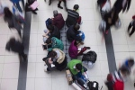 Shoppers take a seat as crowds visit Toronto's Eaton Centre shopping mall on December 26, 2015. (Chris Young/THE CANADIAN PRESS)