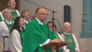 Rev. Brent Hawkes addresses a congregation at the Metropolitan Community Church of Toronto on Feb. 7, 2016.