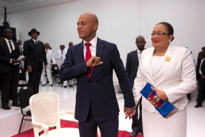 Haiti's President Michel Martelly stands with his wife Sophia before they leave Parliament chambers, in Port-au-Prince, Haiti, Sunday, Feb. 7, 2016. (AP / Dieu Nalio Chery)