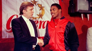 In this March 8, 1984, file photo, Donald Trump shakes hands with Herschel Walker in New York after agreement on a 4-year contract with the New Jersey Generals USFL football team. The New Jersey Generals have been largely forgotten, but Trump's ownership of the team was formative in his evolution as a public figure and peerless self-publicist. (AP Photo / Dave Pickoff, File)