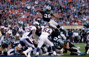 Carolina Panthers' Jonathan Stewart (28) scores a touchdown during the first half of the NFL Super Bowl 50 football game Sunday, Feb. 7, 2016, in Santa Clara, Calif. (Jeff Chiu / AP Photo)