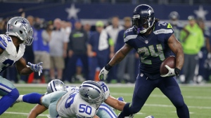 Seattle Seahawks running back Marshawn Lynch breaks through a tackle-attempt by Dallas Cowboys' Sean Lee as Cowboys Byron Jones, left, comes over to help on the running play in the second half of an NFL football game, in Arlington, Texas on Sunday, Nov. 1, 2015. (AP / Brandon Wade)