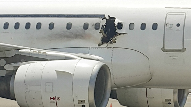 Bomb blows hole in side of jet in Somalia