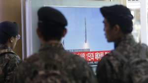 South Korean army soldiers watch a TV news program with a file footage about North Korea's rocket launch at Seoul Railway Station in Seoul, South Korea on Sunday, Feb. 7, 2016. (AP / Ahn Young-joon)