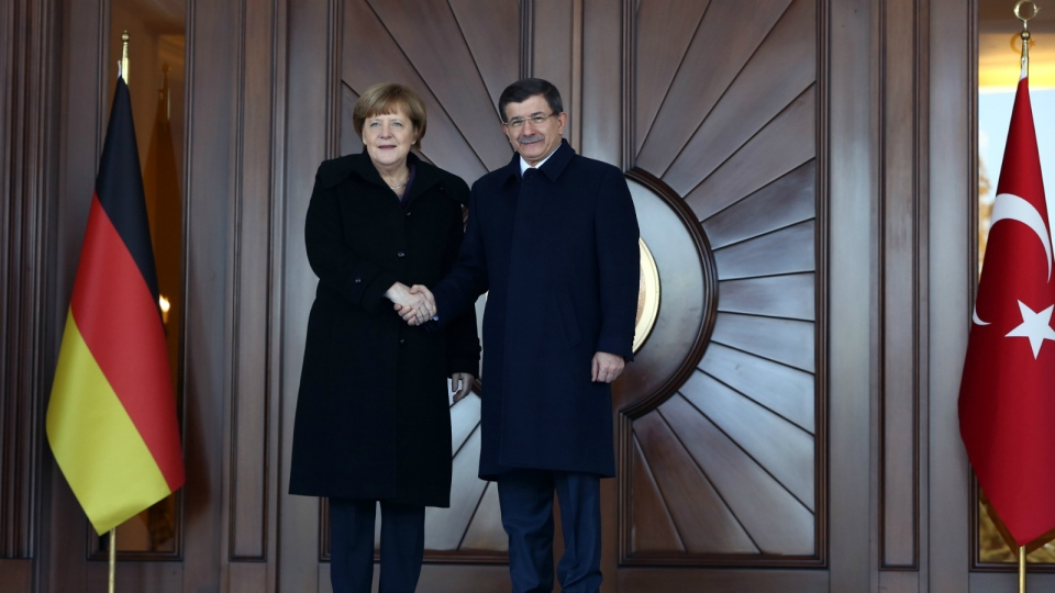 German Chancellor Angela Merkel, left, and Turkish Prime Minister Ahmet Davutoglu shake hands during a welcoming ceremony in Ankara, Turkey, Monday, Feb. 8, 2016. (AP / Burhan Ozbilici)