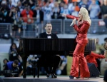 Lady Gaga sings the national anthem before the NFL Super Bowl 50 football game between the Denver Broncos and the Carolina Panthers, Sunday, Feb. 7, 2016, in Santa Clara, Calif. (AP Photo/Julie Jacobson)