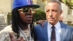 Entertainer Flavor Flav, left, standing with attorney Todd Greenberg, speaks with reporters after pleading guilty to one count of aggravated unlicensed operation of a motor vehicle, Tuesday, Oct. 13, 2015, in Mineola, N.Y. (AP / Frank Eltman)