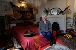 Kathy Etchingham, the former girlfriend of U.S. musician Jimi Hendrix, poses for photographers during a media preview in the bedroom of his former central London flat, at 23 Brook Street, London, Monday, Feb. 8, 2016. (AP/Matt Dunham)