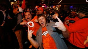Broncos fans celebrate their team's Super Bowl 50 win in Denver, on Feb. 7, 2016. (David Zalubowski / AP)