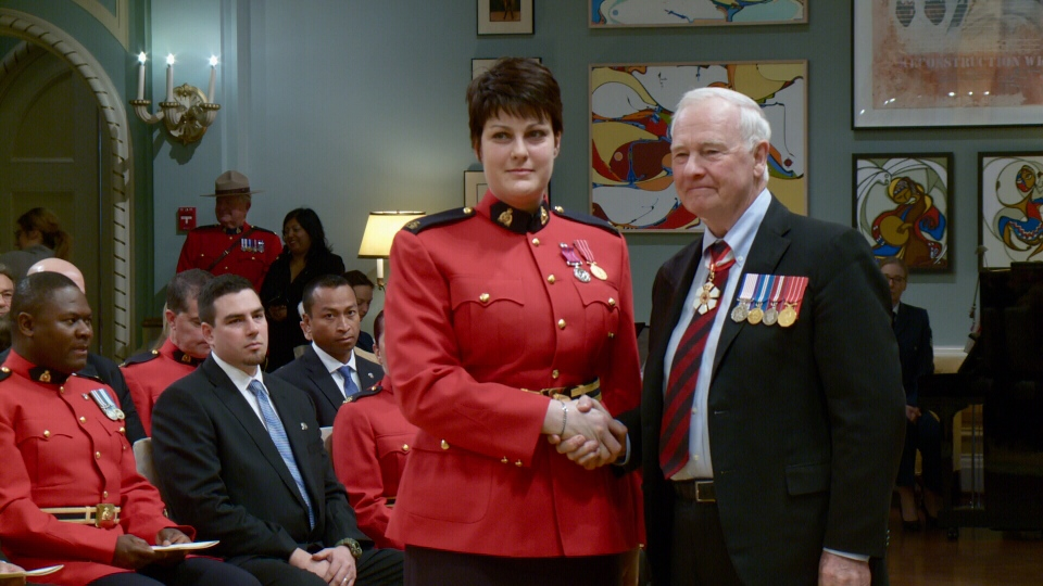 RCMP Const. Michelle Bergeron shakes hands with Gov. Gen. David Johnston at a ceremony in Rideau Hall on Feb. 8, 2016.