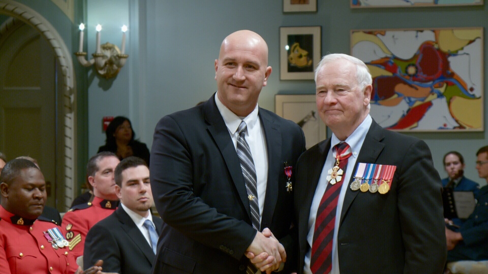 Const.Louis Létourneau receives an award from Gov. Gen. David Johnston at a ceremony in Rideau Hall on Feb. 8, 2016.