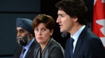 Prime Minister Justin Trudeau answers a question as he is joined by Minister of National Defence Harjit Sajjan, left, and Minister of International Development and La Francophonie Marie-Claude Bibeau during a press conference at the National Press Theatre in Ottawa on Monday, Feb. 8, 2016. (Sean Kilpatrick / THE CANADIAN PRESS)