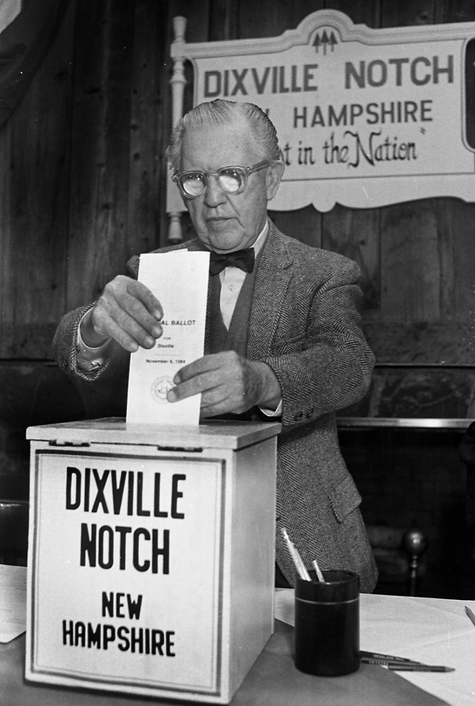 In this Feb. 28, 1984, file photo, Neil Tillotson gets ready to cast the first ballot in the New Hampshire presidential primary in Dixville, N.H. (Jim Cole / AP Photo)