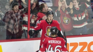 Fans react as Ottawa Senators right wing Mark Stone celebrates his second goal during second period NHL action against the Tampa Bay Lightning in Ottawa on Monday, Feb. 8, 2016. (Adrian Wyld / THE CANADIAN PRESS)