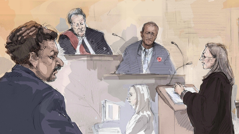 Everton Biddersingh, left, appears in a Toronto court with Justice Al O'Marra, second from left, Cleon Biddersingh (his brother), second from right, and Mary Humphrey (prosecutor), right, on Thursday, Jan. 7, 2016. (Alexandra Newbould / THE CANADIAN PRESS)