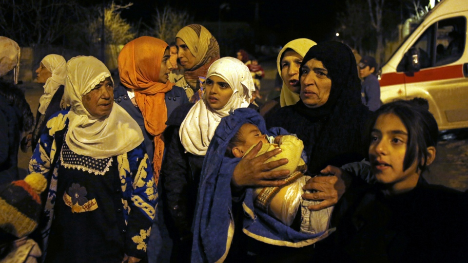 People wait to leave the besieged town of Madaya, northwest of Damascus, Syria, where Doctors Without Borders says dozens of people have died of starvation since September on Monday, Jan. 11, 2016. (AP)