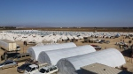 This photo provided by Turkish Islamic aid group IHH, shows a temporary refugee camp for displaced Syrians in northern Syria, near Bab al-Salameh border crossing with Turkey, Monday, Feb. 8, 2016. (IHH via AP)