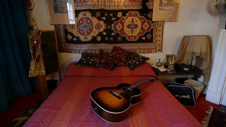 The bed in the former bedroom of U.S. musician Jimi Hendrix at the central London flat he used to live in at 23 Brook Street, London on Monday, Feb. 8, 2016. (AP / Matt Dunham)