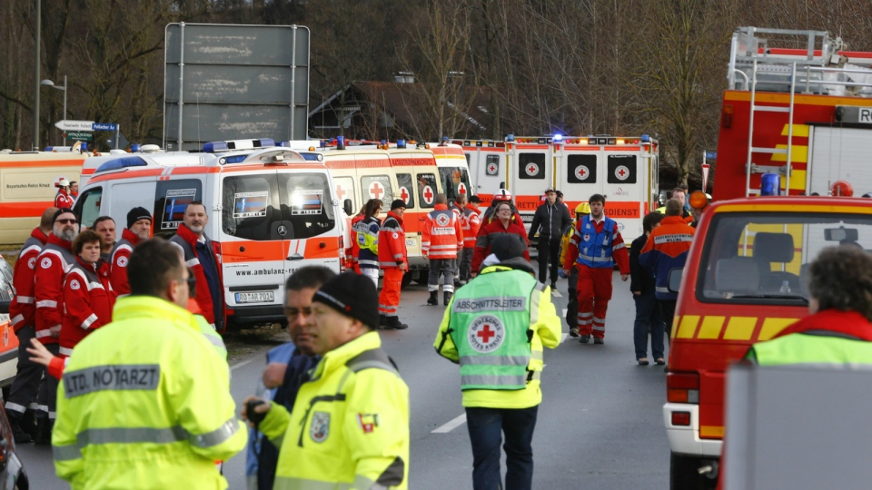 Rescue personnel wait in Bad Aibling, Germany after two regional trains crashed killing at least two people on Tuesday, Feb. 9, 2016. (AP / Matthias Schrader)