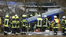 Rescue crews in front of crashed trains in Germany
