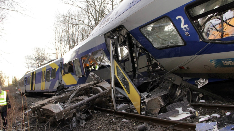 The axis sits separated from the carriage at the site of a train accident near Bad Aibling, Germany, Tuesday, Feb. 9, 2016. (Josef Reissner / dpa)