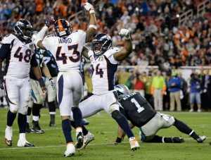 Denver Broncos' DeMarcus Ware (94) celebrates after sacking Carolina Panthers' Cam Newton (1) with Shaquil Barrett (48) and T.J. Ward (43) during the second half of the NFL Super Bowl 50 football game Sunday, Feb. 7, 2016, in Santa Clara, Calif. (AP/Jae C. Hong)