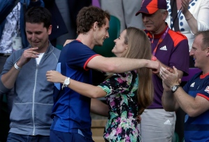In this Sunday, Aug. 5, 2012 file photo, Britain's Andy Murray, center left, hugs his then-girlfriend Kim Sears at the All England Lawn Tennis Club, Wimbledon, in London. (AP/Victor R. Caivano)