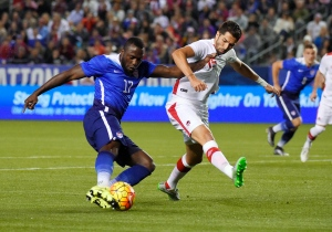 In this Friday Feb. 5, 2016, file photo, United States' Jozy Altidore, left, tries to shoot at goal as Canada's Steven Vitoria vie defends during the first half of an exhibition soccer match in Carson, Calif. (Mark J. Terrill / AP Photo)