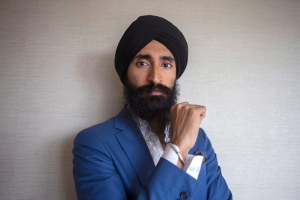 """Actor and designer Waris Ahluwalia is pictured in a Toronto hotel room as he promotes the film """"Beeba Boys"""" during the 2015 Toronto International Film Festival on Saturday, September 12, 2014. (THE CANADIAN PRESS / Chris Young)"""