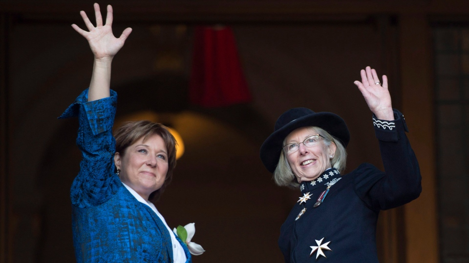 B.C.'s Lieutenant Governor Judith Guichon, right, is greeted by Premier Christy Clark prior to the throne speech in the B.C. Legislature in Victoria, on Tuesday, Feb. 9, 2016. (THE CANADIAN PRESS/Jonathan Hayward)