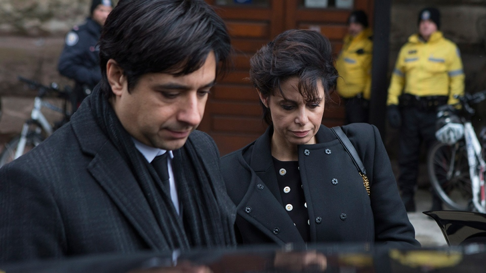 Lawyer Marie Henein leaves a Toronto courthouse with her client Jian Ghomeshi, left, following day six of his trial on Tuesday, Feb. 9, 2016. (Chris Young / THE CANADIAN PRESS)
