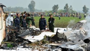 Military personnel inspect the wreckage of a Burma military aircraft that crashed in an area close to the airport in Naypyitaw, Burma on Wednesday, Feb. 10, 2016. (AP / Aung Shine Oo)