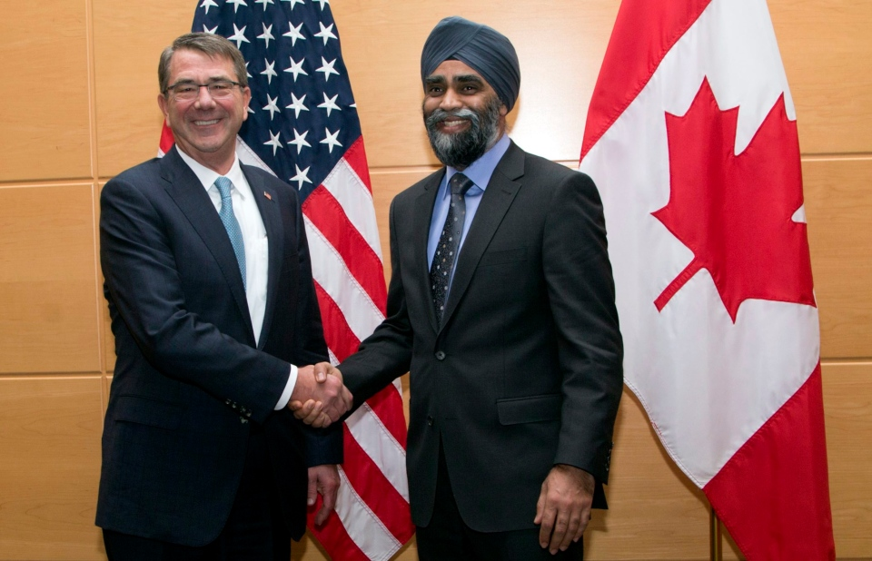 U.S. Secretary of Defense Ash Carter, left, shakes hands with Canadian Defense Minister Harjit Singh Sajjan prior to a bilateral meeting at NATO headquarters in Brussels on Wed., Feb. 10, 2016. (AP / Virginia Mayo)