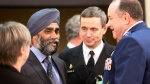 Defence Minister Harjit Singh Sajjan, second left, speaks with Supreme Allied Commander Europe, Gen. Philip Breedlove, right, during a meeting of the North Atlantic Council at NATO headquarters in Brussels on Wednesday, Feb. 10, 2016. (AP Photo/Virginia Mayo)