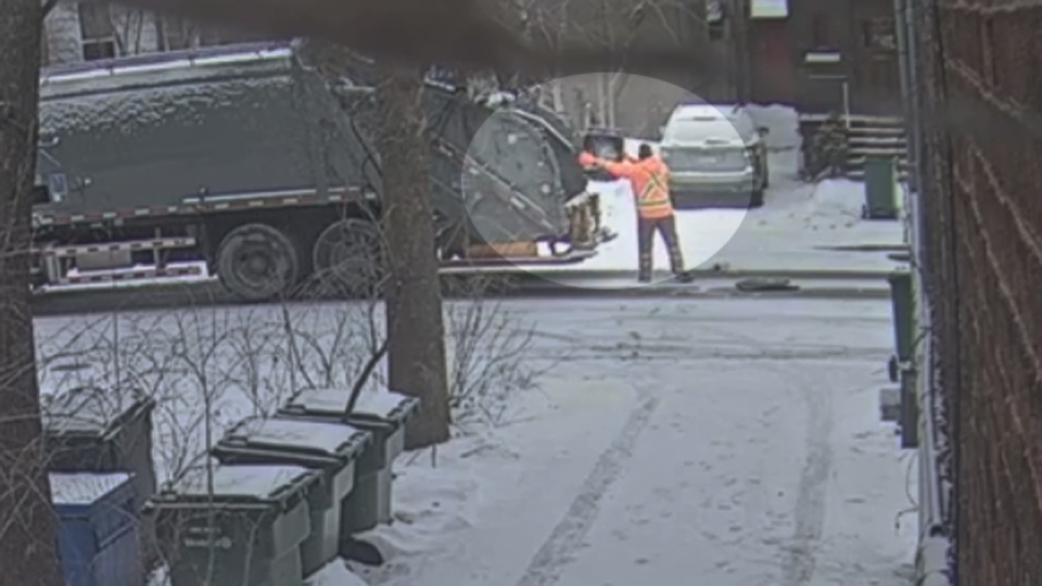 A Montreal trash collector throws the can in the trash on Harvard Ave. on Feb. 9, 2016 (Surveillance video)