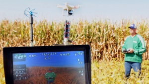 Farmer Matt Boucher demonstrates a drone in Dwight, Ill., on Sept. 18, 2014   the maneuverabiliy of the craft at his farm. (The Daily Journal, Scott Anderson / THE CANADIAN PRESS / AP)