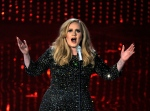 In this Feb. 24, 2013 file photo, singer Adele performs during the Oscars at the Dolby Theatre in Los Angeles. (Chris Pizzello/Invision/AP)