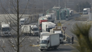 South Korean vehicles returning from North Korea's joint Kaesong Industrial Complex pass the customs, immigration and quarantine office near the border village of Panmunjom, in Paju, South Korea on Thursday, Feb. 11, 2016. (AP / Ahn Young-joon)