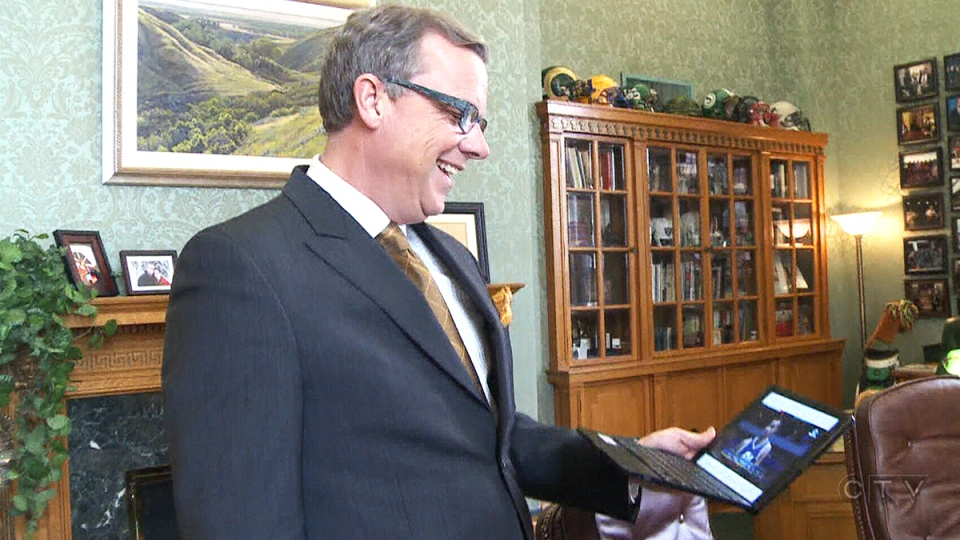 Saskatchewan Premier Brad Wall laughs at a comment made by a Fox Sports announcer about Utah Jazz forward Trey Lyles, Wednesday, Feb. 10, 2016.