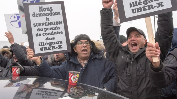 Taxi drivers take part in an anti-Uber protest at Trudeau Airport Wednesday, Feb. 10, 2016 in Montreal. (Ryan Remiorz / THE CANADIAN PRESS)