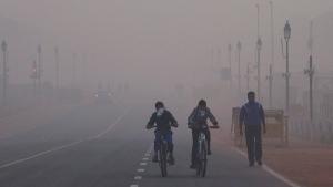 Cyclists ride in New Delhi, India, Tuesday, Jan. 5, 2016. (AP Photo/Manish Swarup)