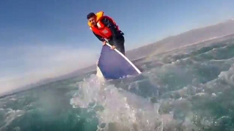 A screen grab of a Turkish Coast Guard rescue of a migrant from a sinking boat.