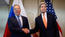 Lavrov and Kerry shake hands in Munich