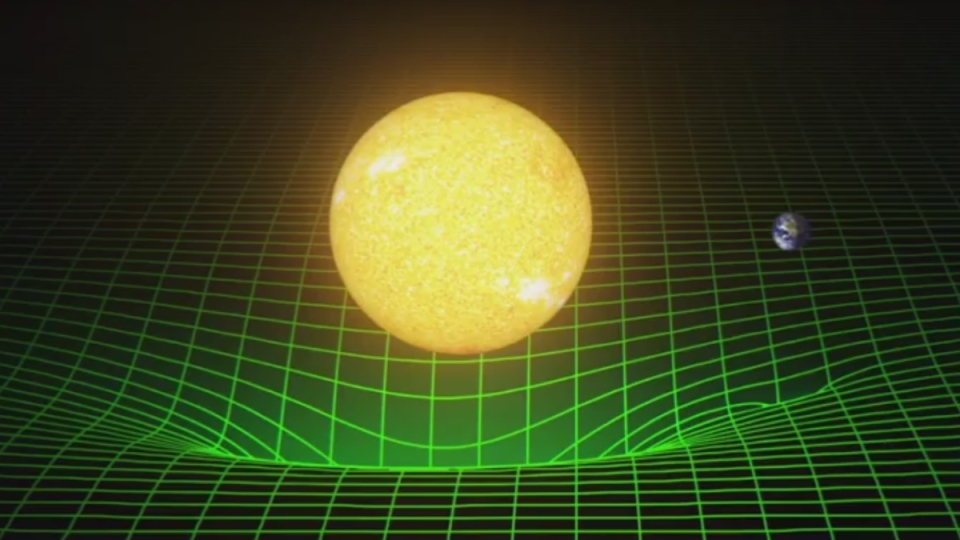 A model of the sun and the Earth warping space-time is shown in this image displayed during a presentation by LIGO. (LIGO via National Science Foundation)